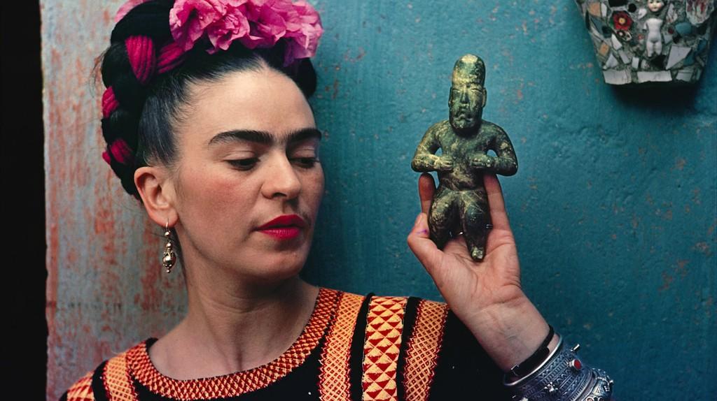 Frida Kahlo with Olmec figurine, 1939