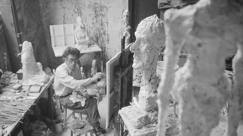 Alberto Giacometti painting in his Paris studio, 1958