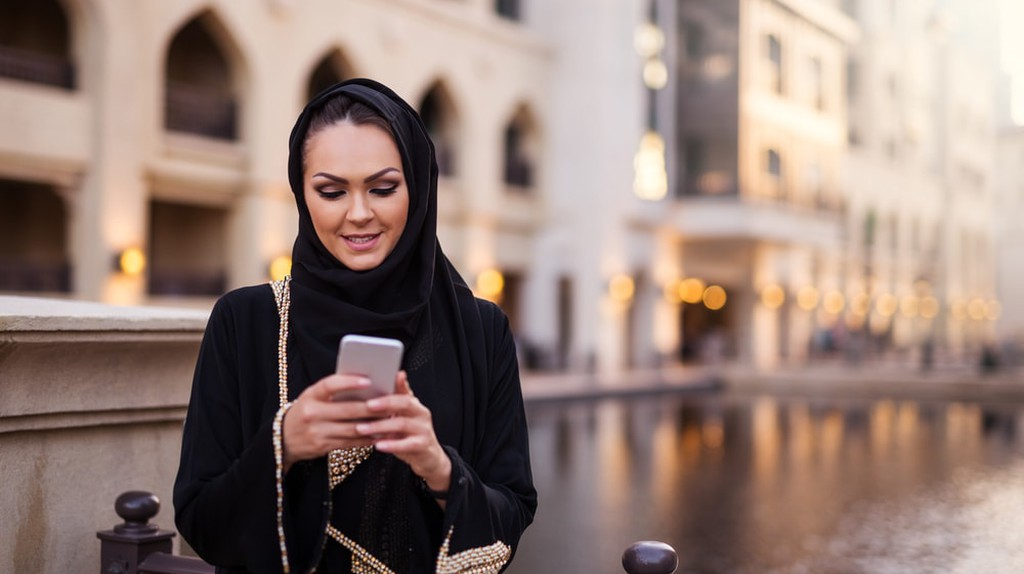 Muslim woman using mobile phone