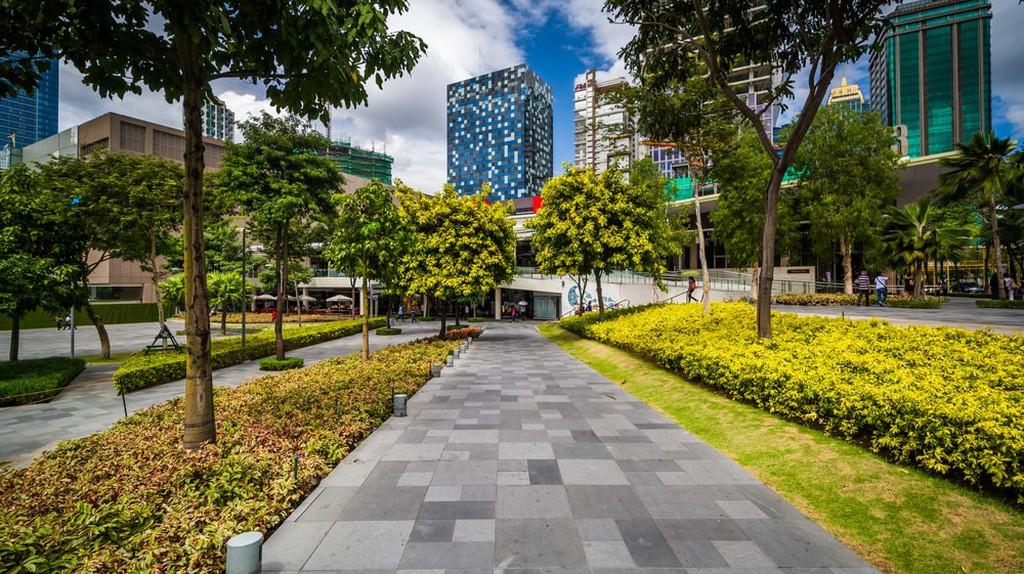 Walkway at a park and skyscrapers at Bonifacio Global City, Metro Manila, Philippines