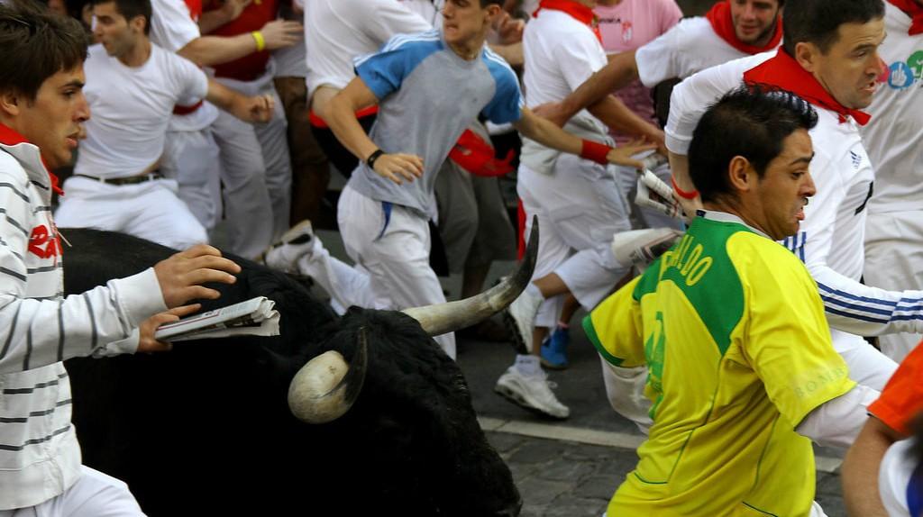 People taking part in an encierro, or bull run, in Pamplona