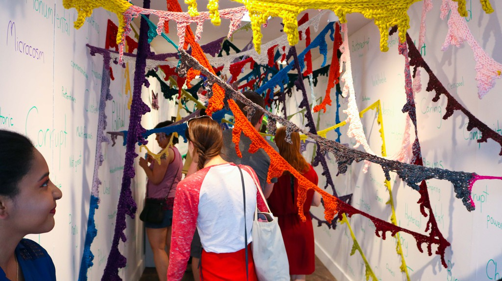 "Truxton Circle, D.C. visitors explore ""In a Word,"" Amy Wike's knitted installation inside CulturalDC's Mobile Art Gallery"