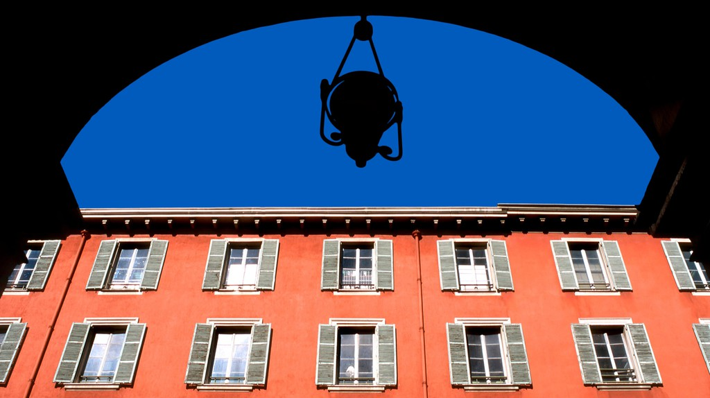 Avenue Jean Medecin (Main Shopping Street) Building facade viewed from the arches of arcade, Nice, France