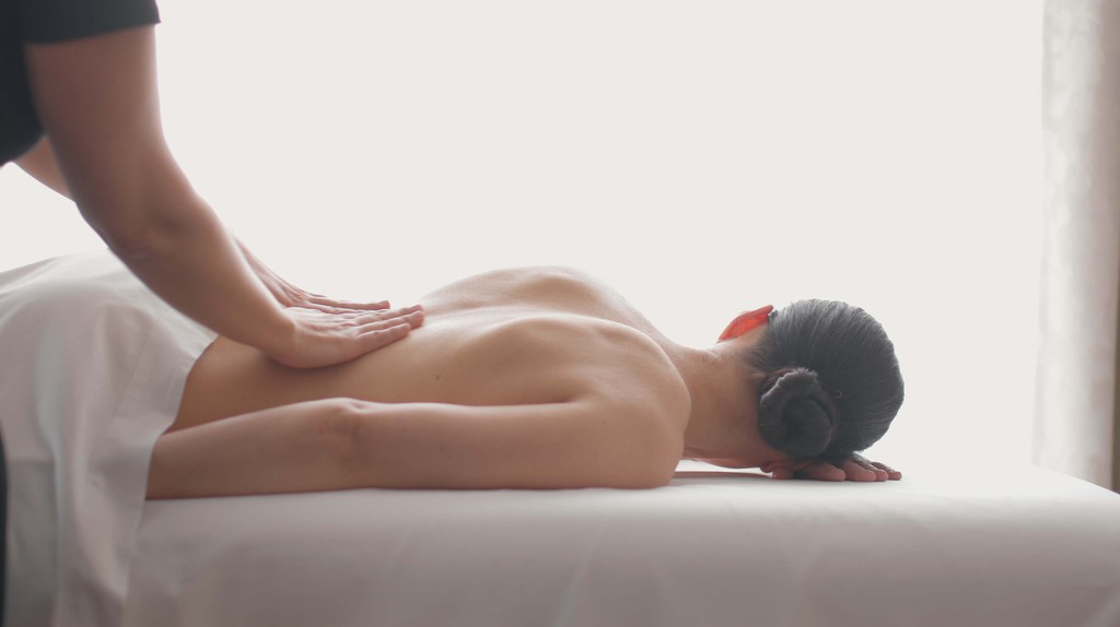 A massage therapist provides a relaxing massage to a customer at the Four Seasons at Las Colinas