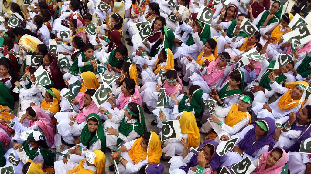 School children in Pakistan are dressed in the colours of the national flag