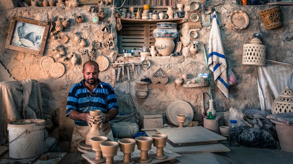 A craftsman at work in A'ali village, Bahrain, known for its pottery
