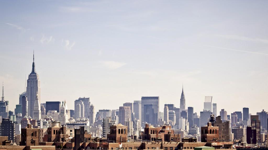 The New York City skyline as seen from the Brooklyn Bridge