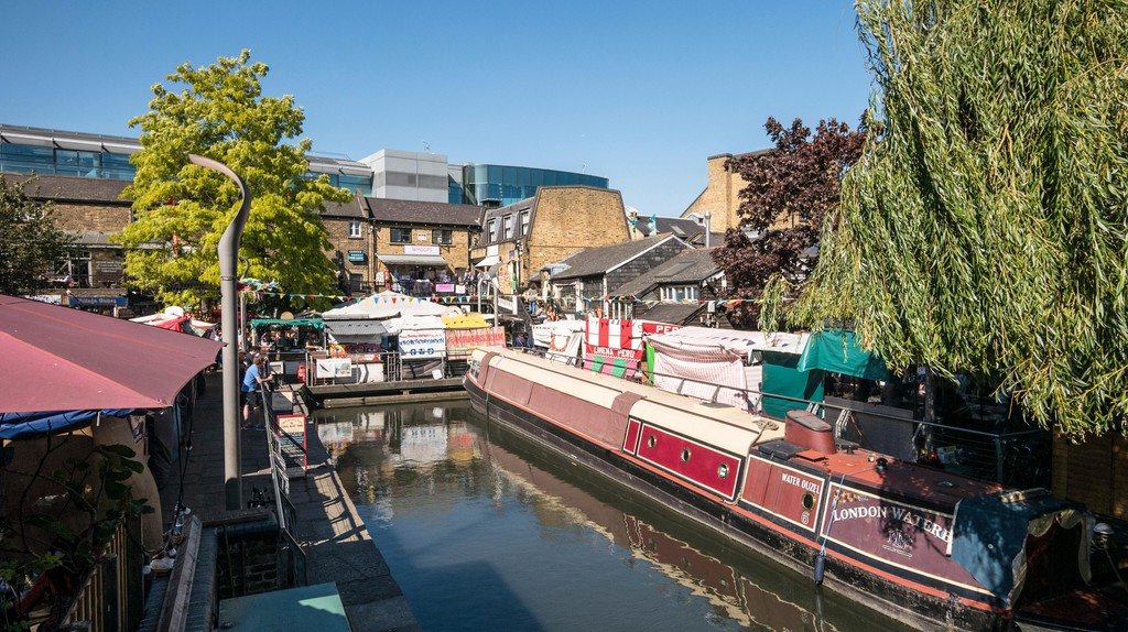 Market stalls line the canal in Camden, London
