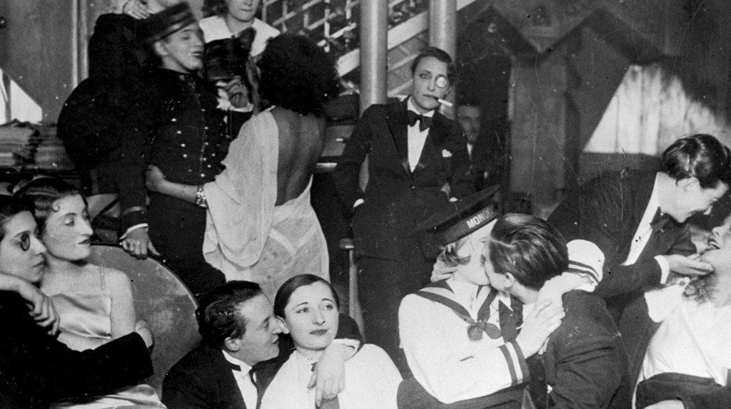 A group of patrons, many dressed as men in tuxedos, at Le Monocle, a famous nightclub for women