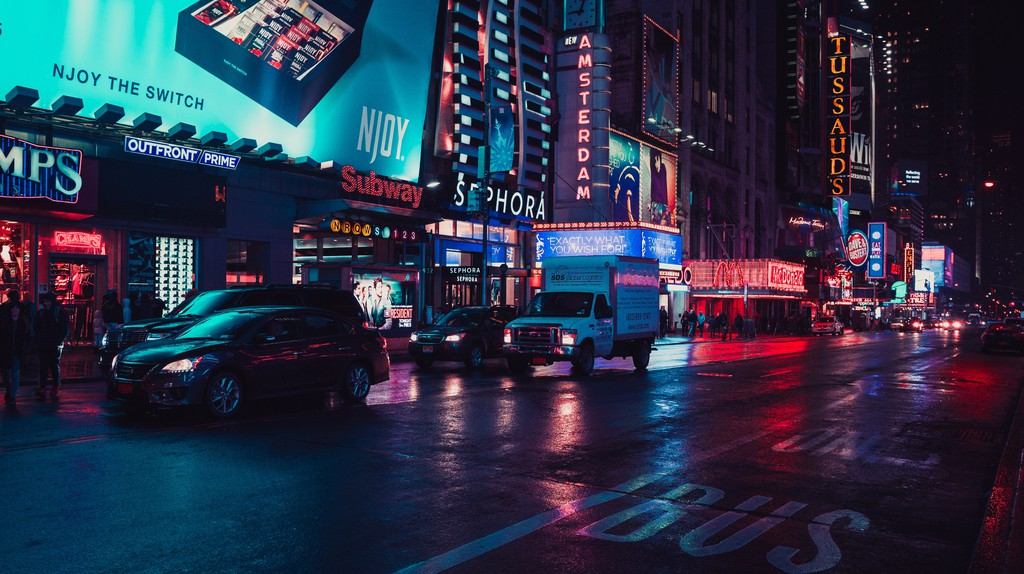 Bright lights illuminate the streets of Manhattan, New York
