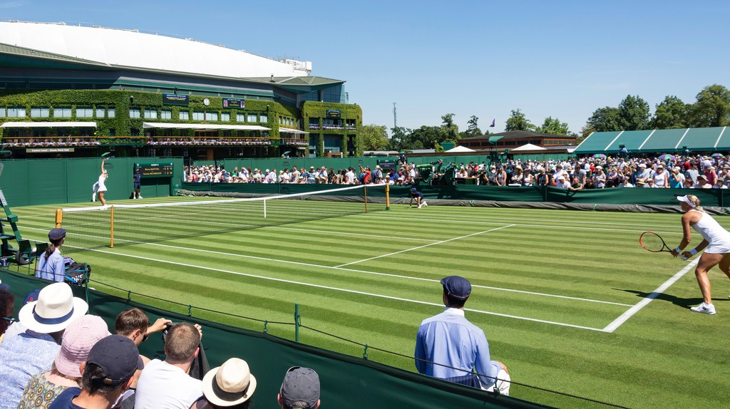 Woman's match on outside court 8 at The Championships 2018, Wimbledon