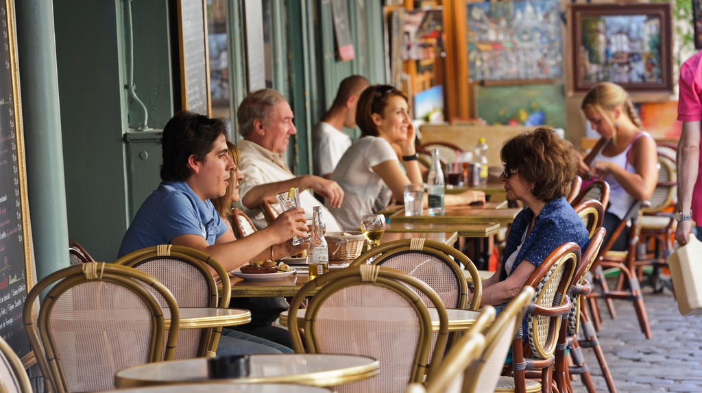 People relax in a restaurant in Paris