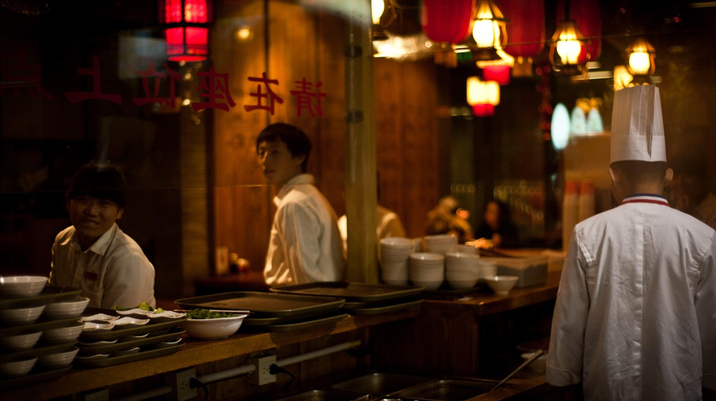 Waiters and the chef in a restaurant in Qianmen, Beijing