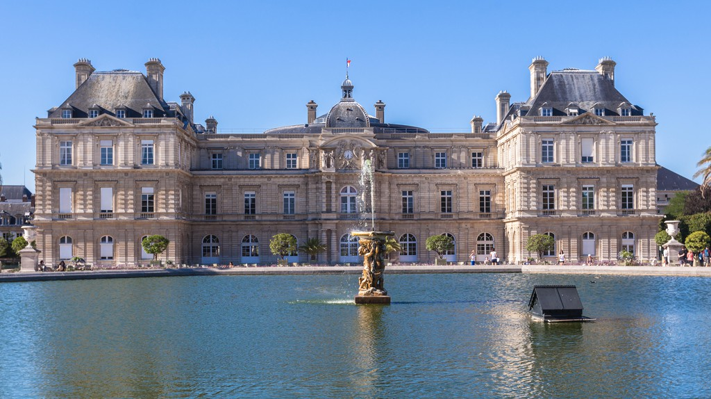 People explore the Jardin du Luxembourg and take in the view of the Luxembourg Palace