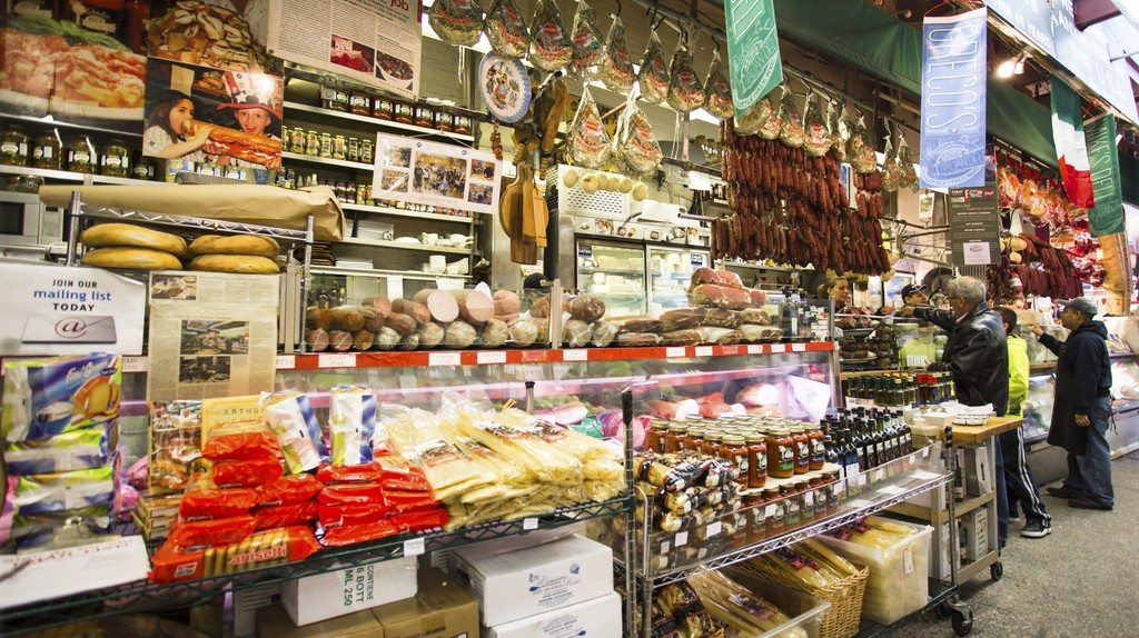 Shoppers place orders at a deli in Little Italy in the Bronx