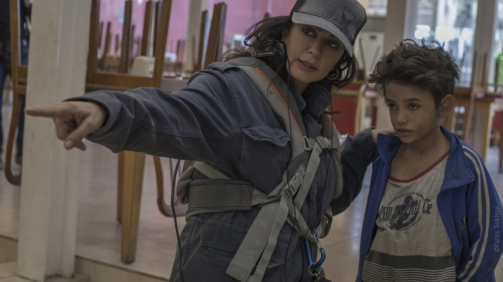 Nadine Labaki speaks with Zain Al Rafeea on the set of 'Capernaum'