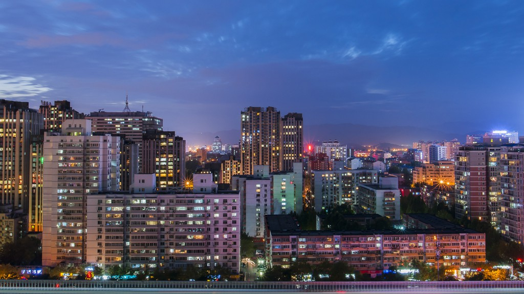 The skyline glows at night in Beijing, China