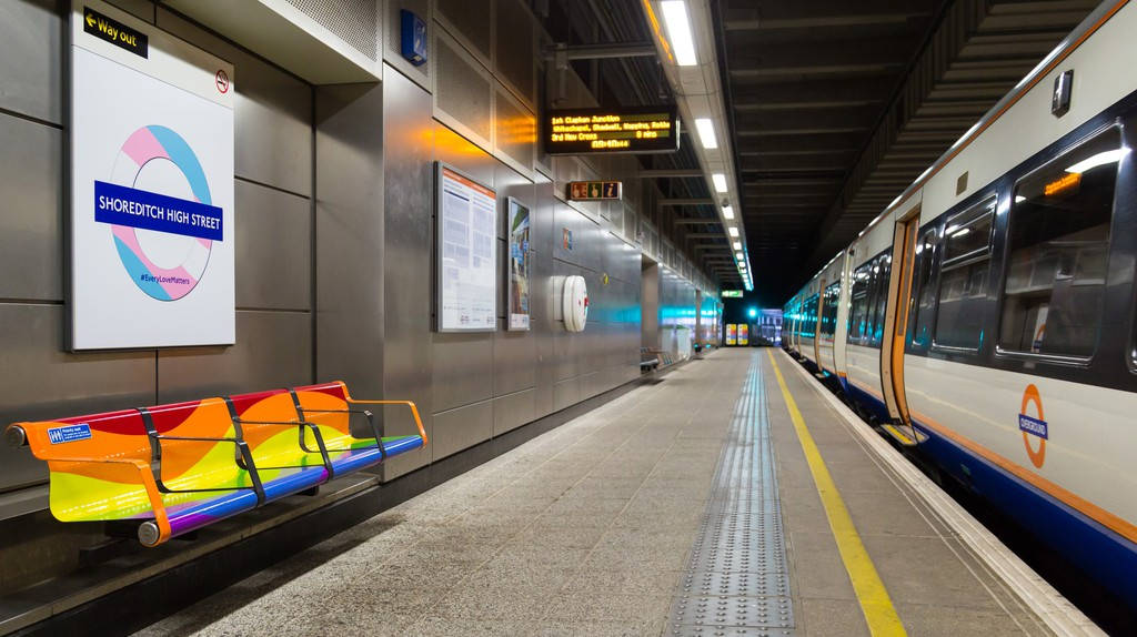 Coloured roundels and benches at Shoreditch High Street station for Pride