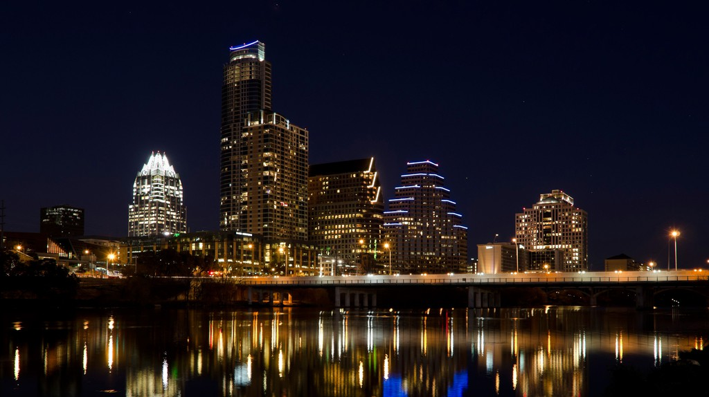 Skyline at night from across Lady Bird Lake, Austin, Texas, USA.