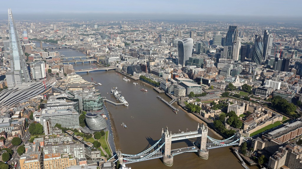 An aerial view shows off the Tower Bridge, Shard, Thames and City of London skyline