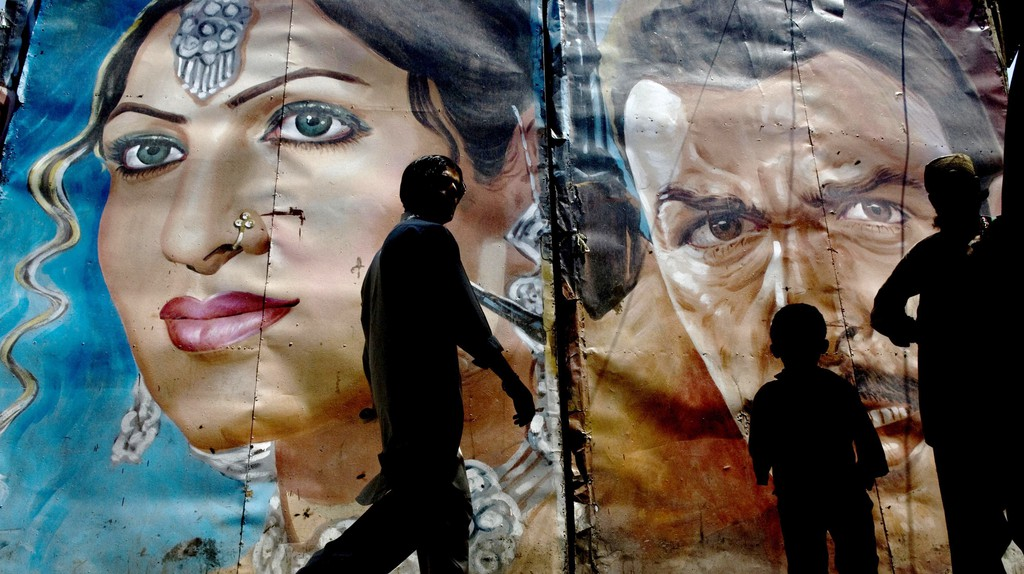 Vintage movie posters cling to the walls in Lahore's Old City