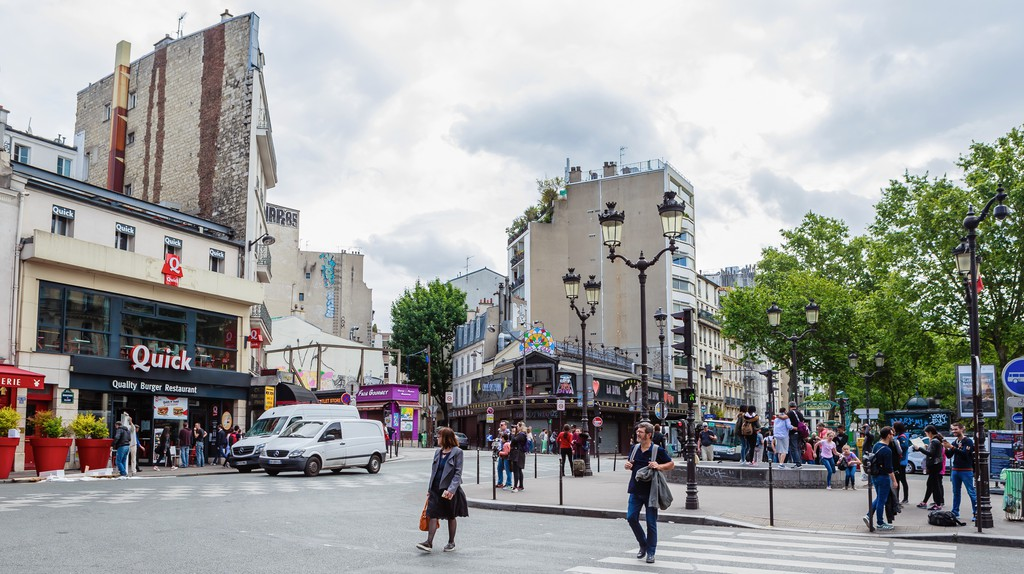 Pedestrians roam Pigalle trying to decide where to eat