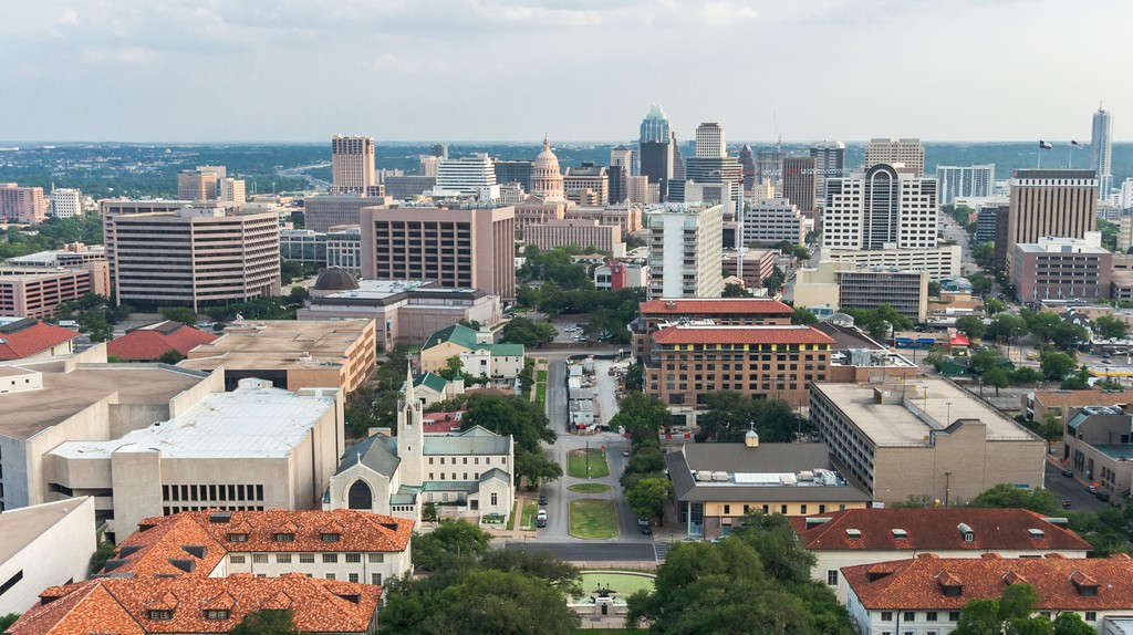 Aerial panorama of downtown Austin and Texas State Capitol from University of Texas Main Building Tower, Austin, Texas, USA.