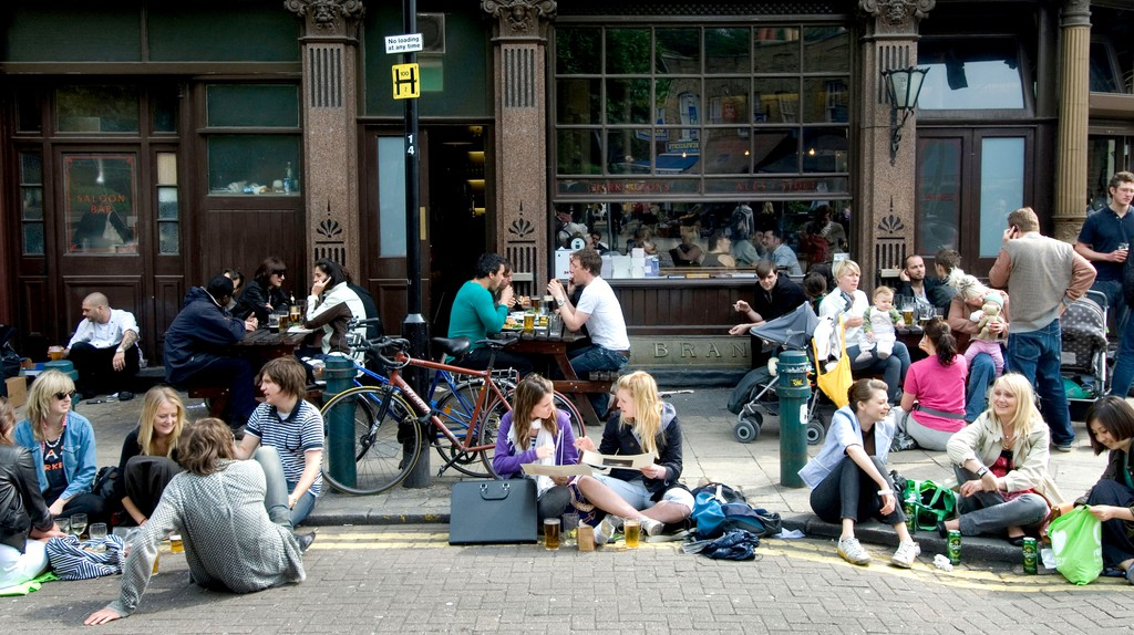 Punters spill out onto the pavement in the sun at London Fields pub the Cat & Mutton