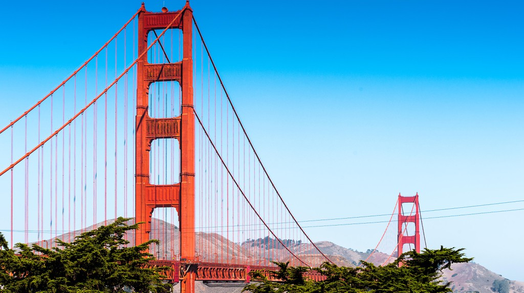 The Golden Gate Bridge stretches across the mouth of the bay to the Marin Headlands