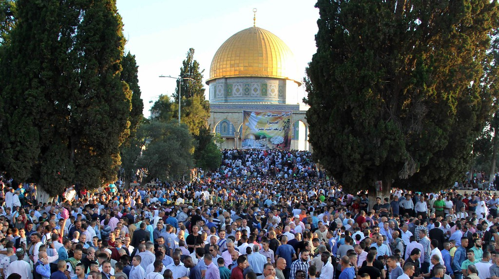 Palestinian Muslims after performing the morning Eid al-Fitr prayer near the Dome of Rock at the Al-Aqsa Mosque compound, Islam's third most holy site, in the Old City of Jerusalem