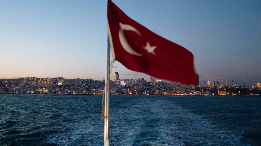 The Turkish flag flies over the Bosporus on the back of a ferry
