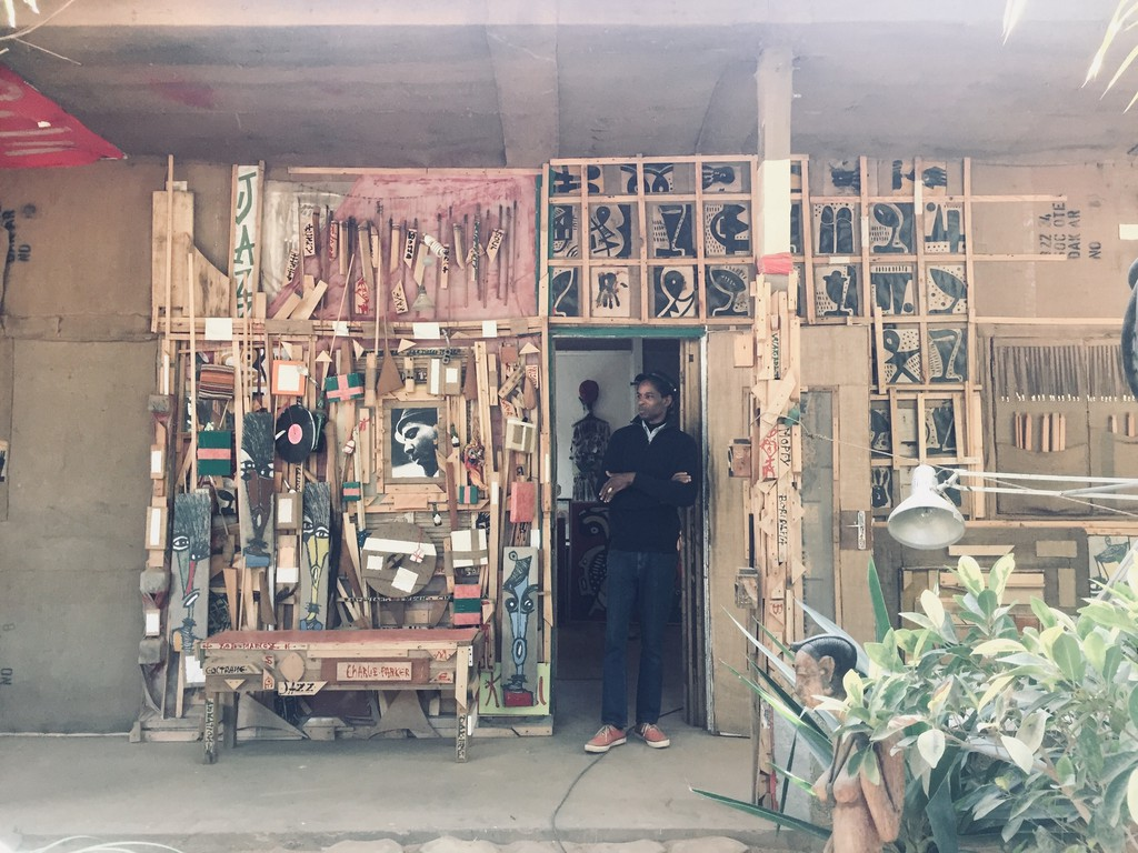 An artist outside his workshop in the Villages des Arts