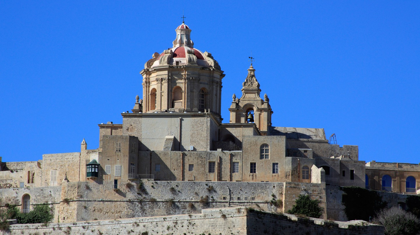A view of the walls and towers of the Co Cathedral of the ancient city of Mdina, Malta