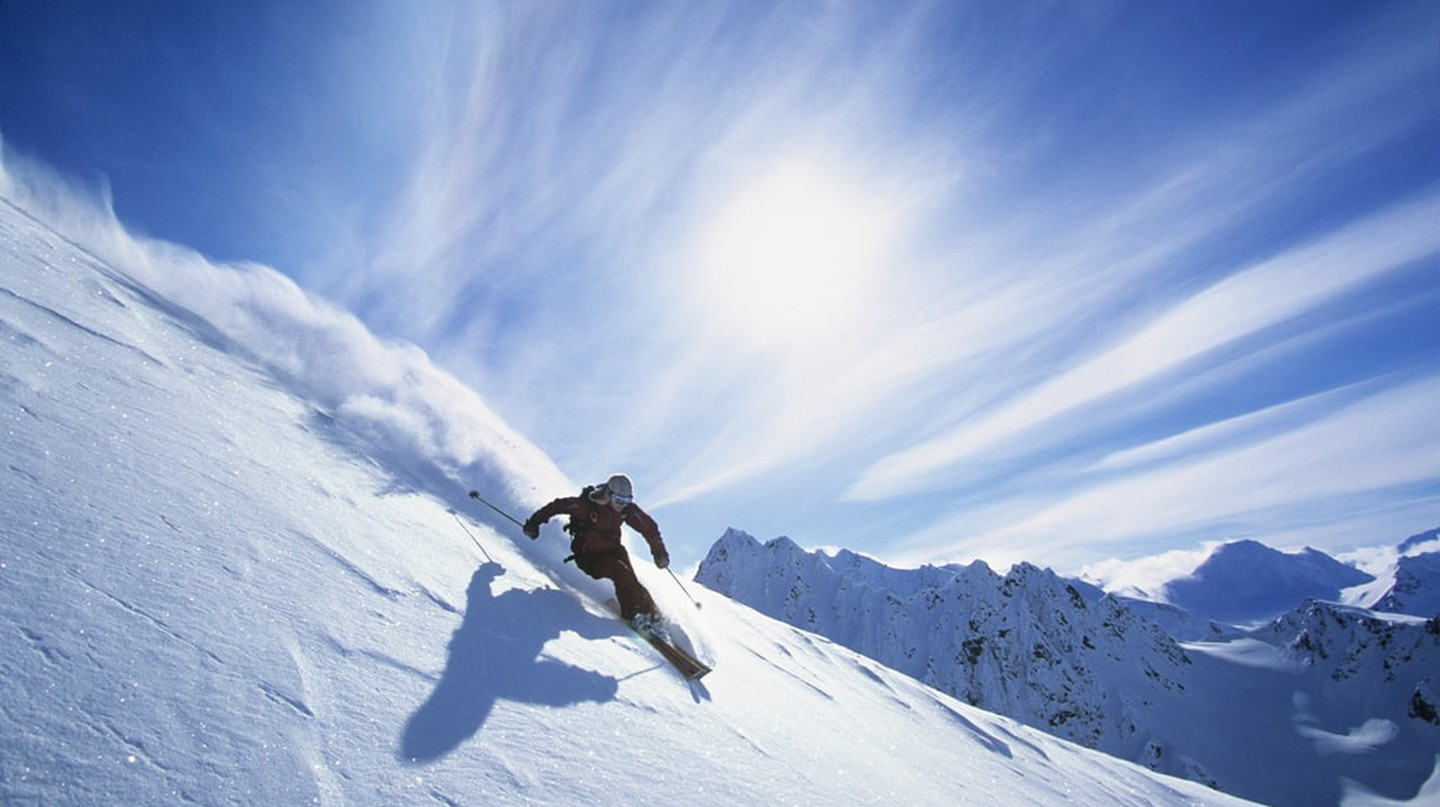 Skier skiing on fresh powder snow