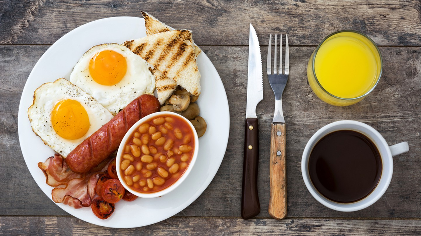 A traditional full English breakfast includes sausages, bacon, eggs, tomatoes, mushrooms and bread