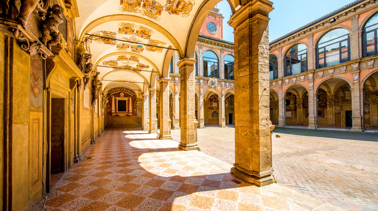 The inner yard of the Archiginnasio of Bologna that houses the Municipal Library and the famous Anatomical Theatre | © RossHelen/Shutterstock
