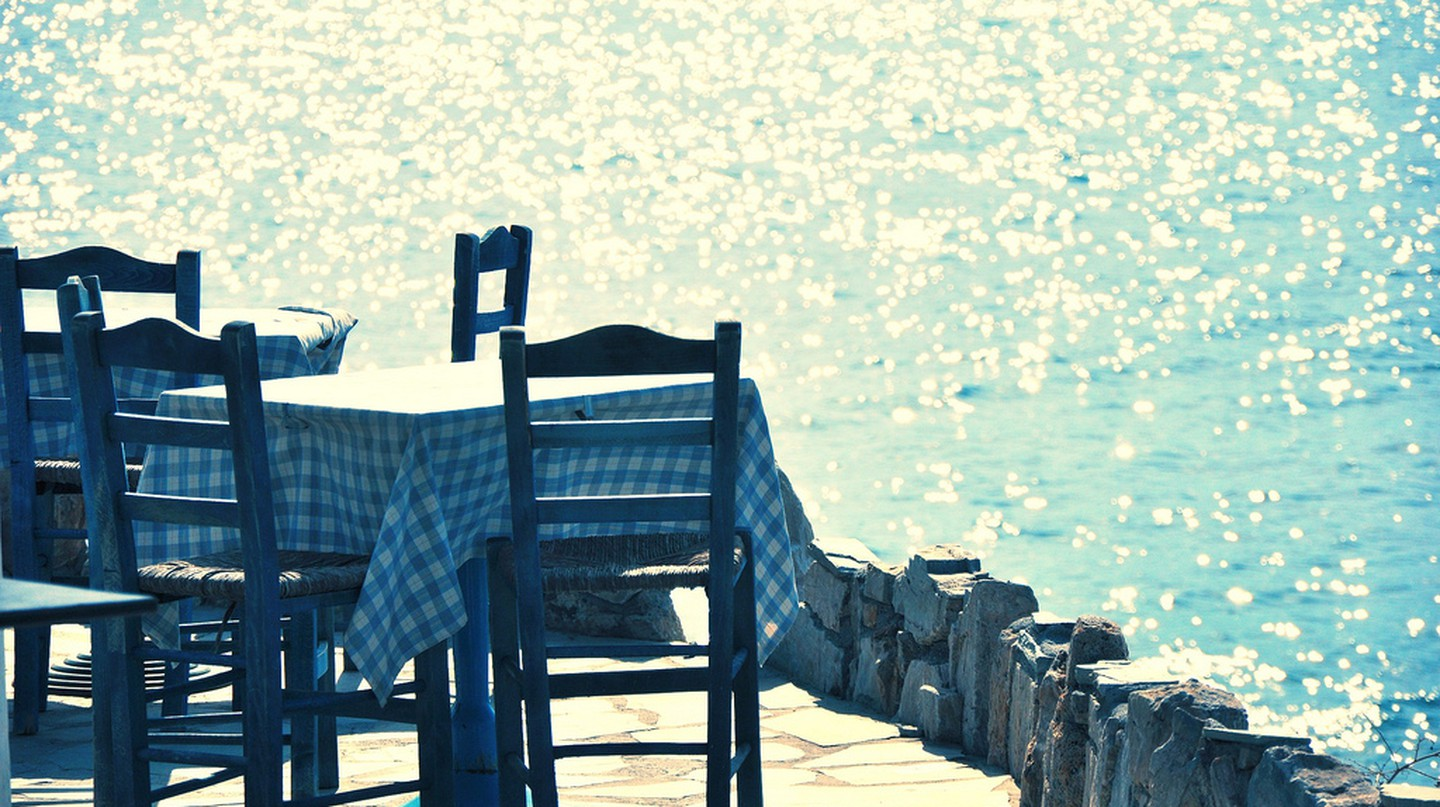 Table by the Sea in Greece © George Pachantouris/Flickr