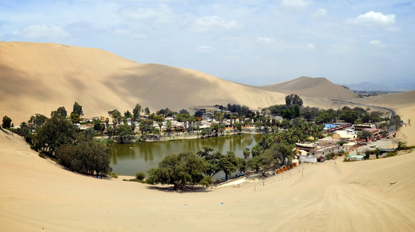 The Huacachina Oasis, in the desert sand dunes near the city of Ica, Peru © Marktucan / Shutterstock