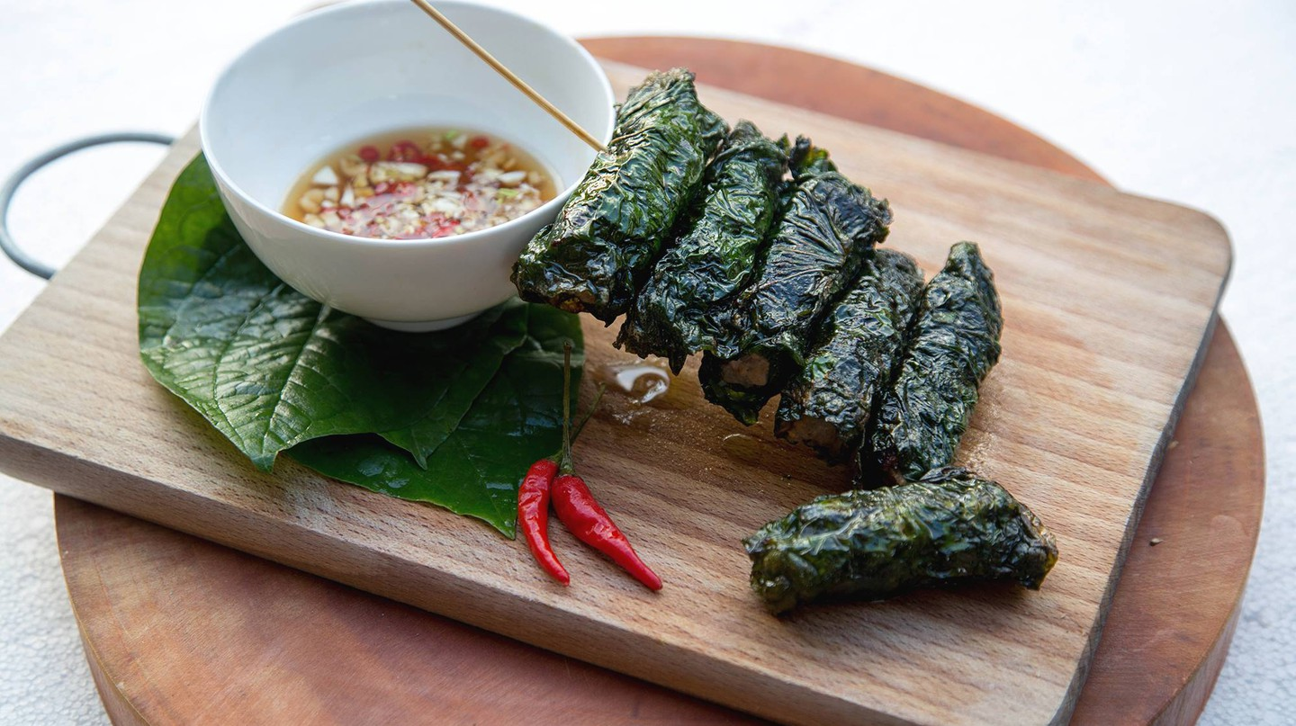 Pork wrapped in betel leaves