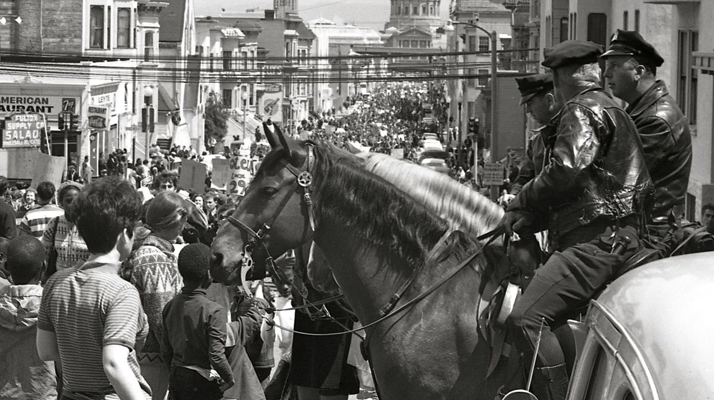 Mounted policemen watch a protest march in San Francisco on April 15, 1967. The San Francisco City Hall is in the background | © George Garrigues/WikiComons