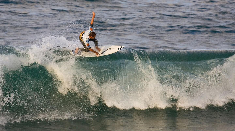 Tom Whittaker of Australia surfs during round 2 of the Billabong Pro Mundaka