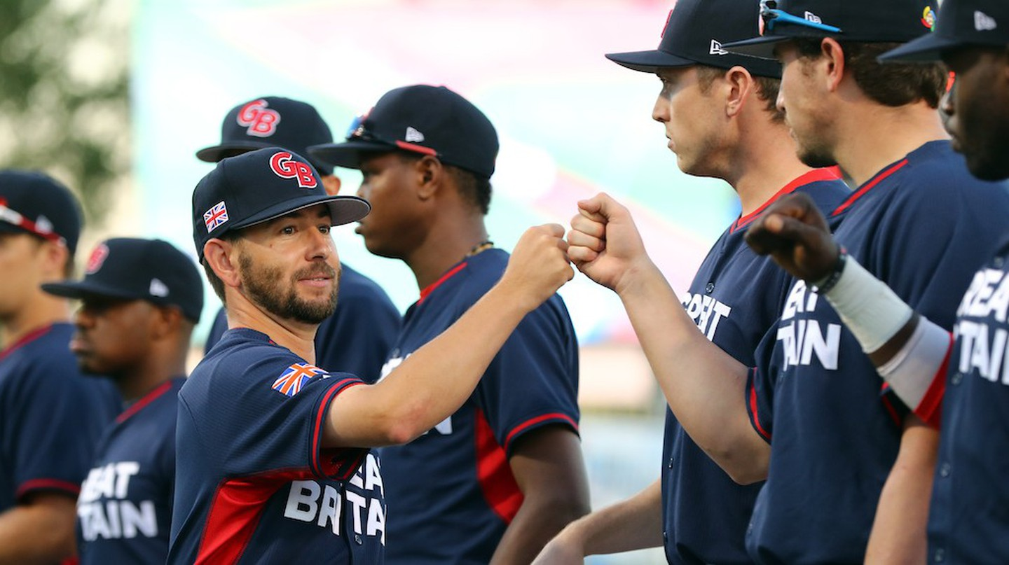 Great Britain manager Liam Carroll greets his players ahead of Game 2 of the 2016 World Baseball Classic Qualifier|© Alex Trautwig/MLB Photos via Getty Images