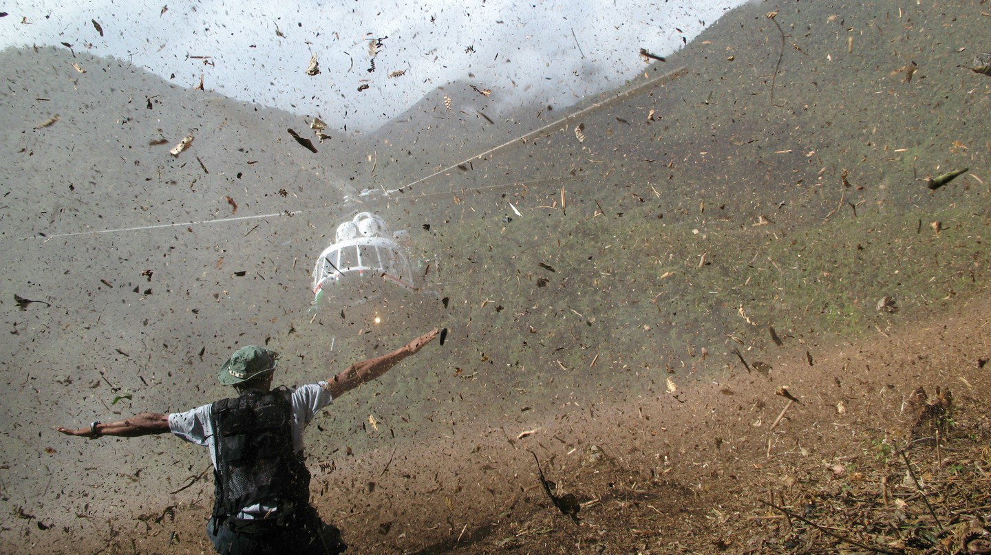 A helicopter lands in the Peruvian rainforest | Courtesy Thierry Jamin.