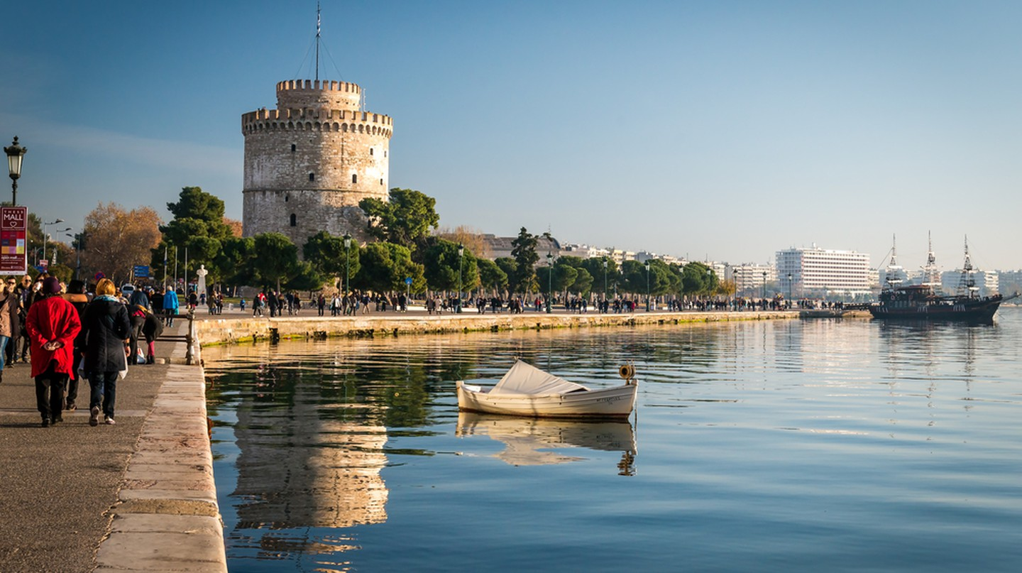 Thessaloniki next to the white tower which once guarded the eastern end of the city's seawalls