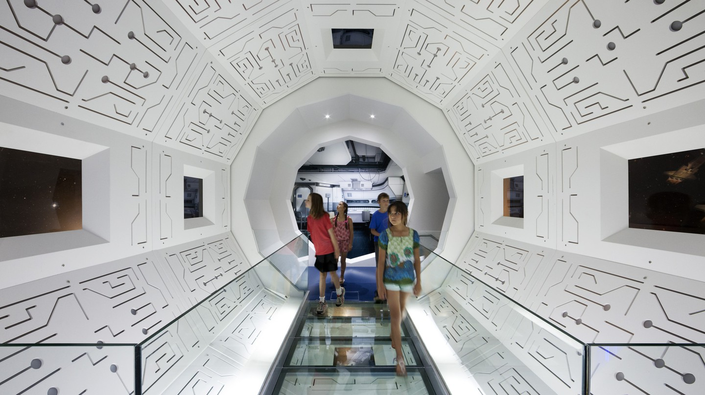 Think Ahead Exhibition, Scienceworks. Children exploring the 'Life in Space' installation. White panels, space ship like interior. | Courtesy of Scienceworks