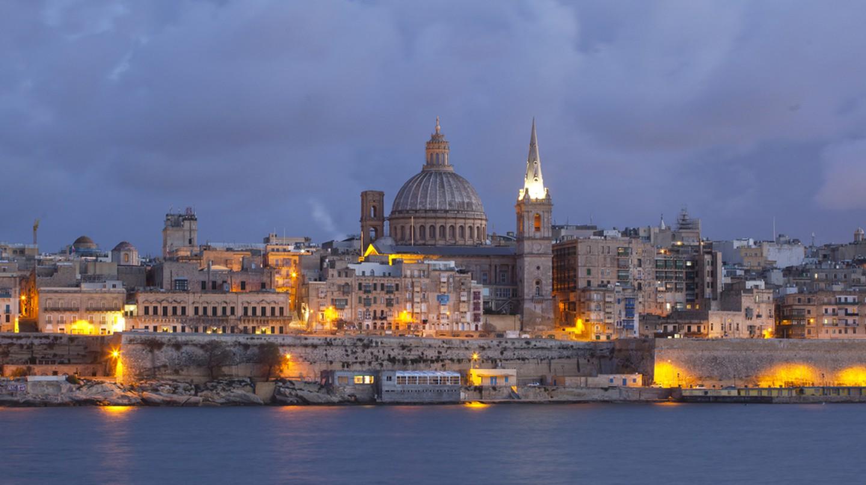 City of Valletta Malta at Sunset captured from Silema Bay | © Gaborturcsi/Shutterstock