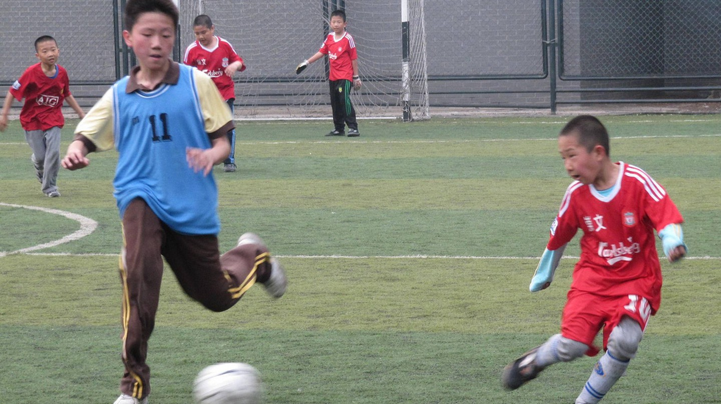 Kids playing soccer in Beijing | © Flickr/Ivan Walsh