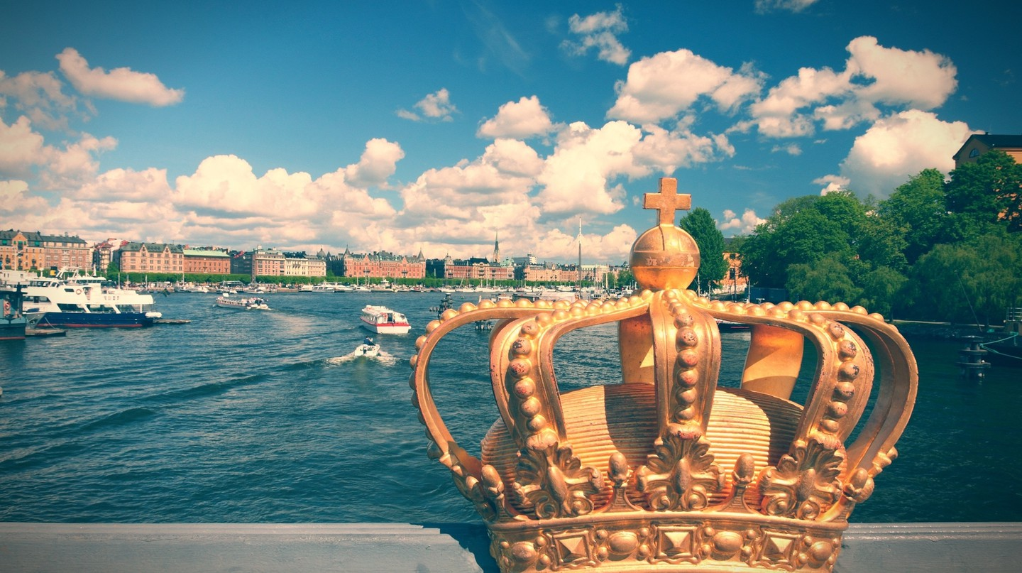 Stockholm, Sweden. Skeppsholmsbron (Skeppsholm Bridge) with its famous gilded crown and Strandvagen in background|© Tupungato/Shutterstock