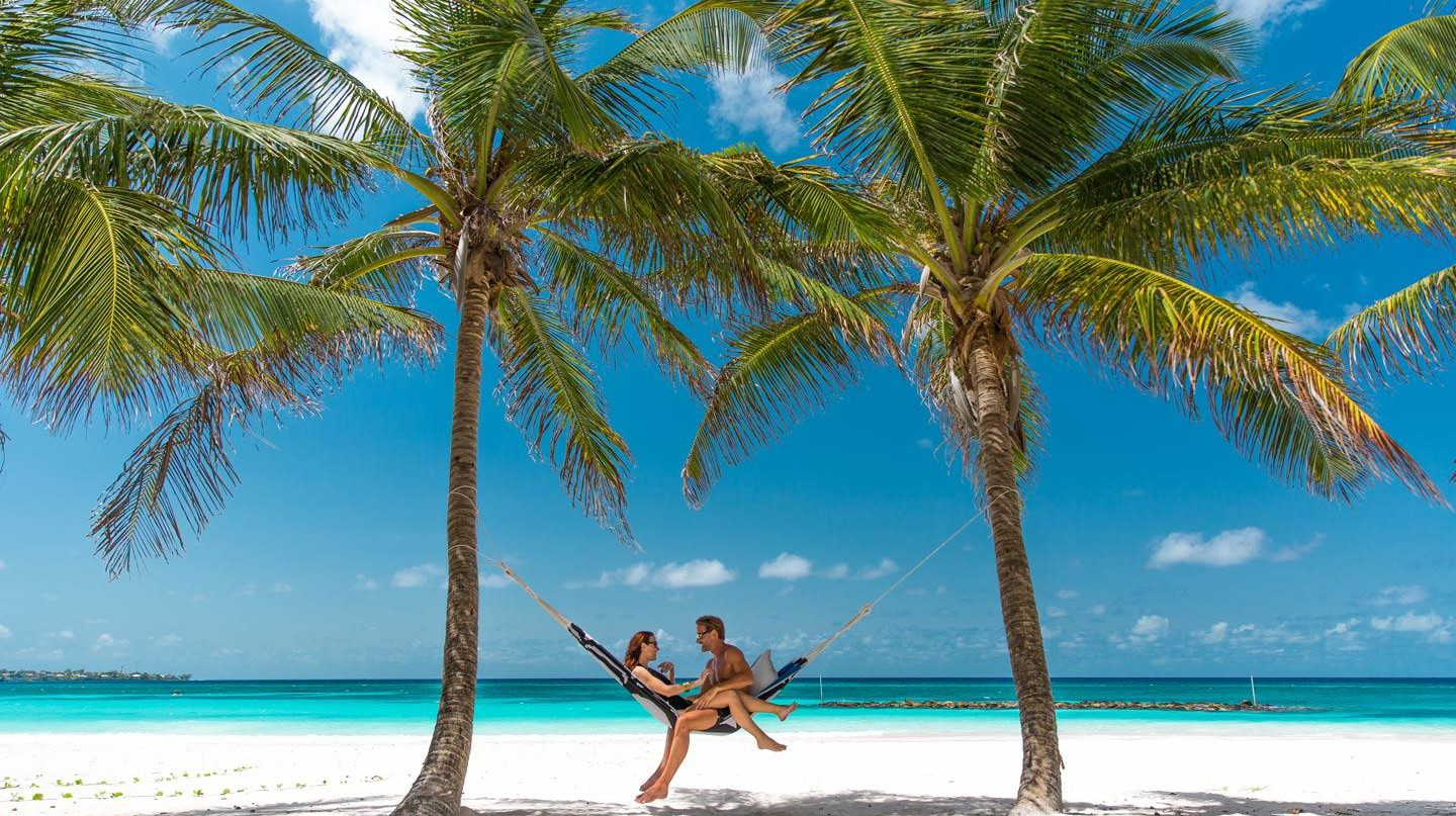 Beach side hammocks for two | Courtesy of Sandals Barbados