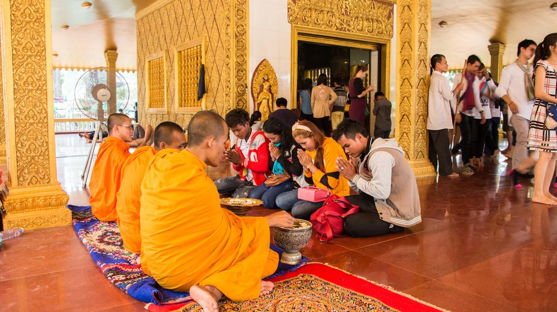 Cambodians visit pagodas during Khmer New Year to give offerings | ©  Vassamon Anansukkasem/ Shutterstock